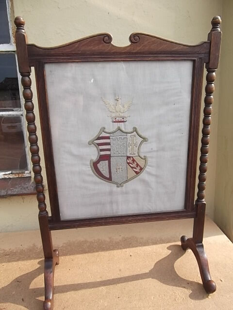 Antique fire screen - Oak fire screen with embroidered linen coat of arms